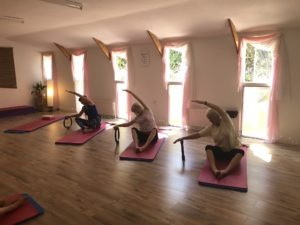 Yoga & Pilates Newton Abbot, yoga Torquay, Pilates Torquay class of ladies sat on floor